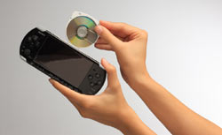 UMD disc being inserted into a Piano Black PSP-3000