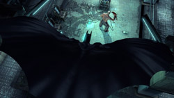 Batman gliding in on an enemy in Batman: Arkham Asylum