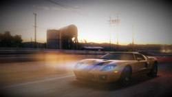 Car speeding solo down a course at sunset in 'Blur'