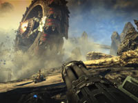 Looking down the barrel of your weapon at a rampaging enemy vehicle in Bulletstorm