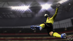 A goalkeeper stretching for a ball in FIFA Soccer 11
