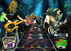 Diverse characters on stage side by side in Guitar Hero II