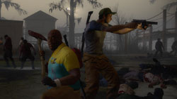 Survivors using a mix of melee and firearms against zombies in Left 4 Dead 2