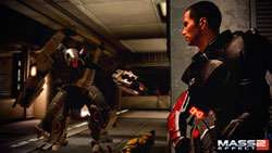 Commander Shepard ambushing a mech in Mass Effect 2