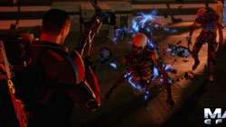 Mass Effect 2's new damage system illustrated as an enemy continues to pursue Shepard even with its legs are blown off