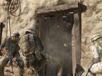 A squad of soldiers kicking in a door in Medal of Honor