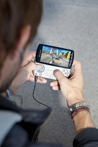 Lifestyle image utlising game pad on Xperia PLAY handset