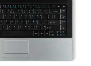 The silver palmrest area is an attractive partner to the glossy black cover, and contains a large multi-gesture touchpad