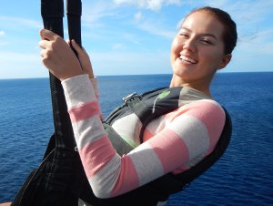 Picture shows a portrait shot of a young woman parasailing (taken at 48 metres above sea-level).