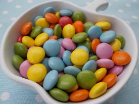 Picture shows a close-up view of a bowl of sweets.