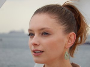 Picture shows a close up of a woman's face illustrating the quality telephoto zoom and the Glamour Retouch effect tool.