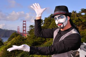 Picture shows a street performer with the Golden Gate Bridge in the background.