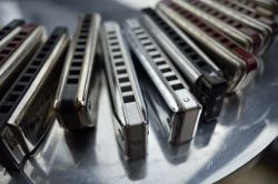 Picture shows a close-up view of a harmonica.