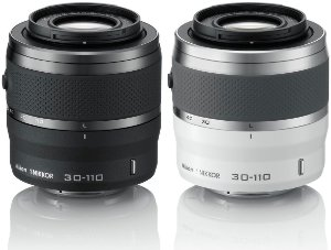 Close-up view of the two available colours (black and white) of the 30-110mm zoom lens.