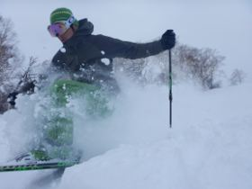 Close-up, dynamic view of a skier.