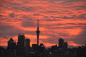 Picture shows the skyline of Auckland, New Zealand at sunset.
