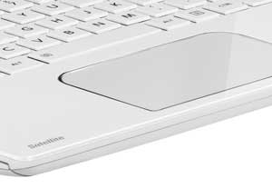 The full-sized keyboard and large numerical keypad are surrounded by a premium gloss finish.