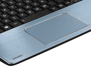 The premium brushed-metal finish continues inside, surrounding the large, button-free touchpad.