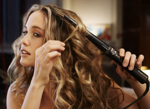 The Remington Pearl Curling Wand in action creating loose curls