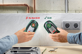 The Bosch PDO Multi's display changes from green to red when materials are detected behind the wall