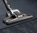Dual mode floor tool, moving from carpet to a wooden floor