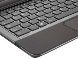The A4-sized keyboard features matt black tile keys and an LED backlight.