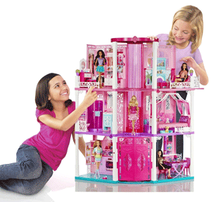 Girls playing with the Barbie Dreamhouse
