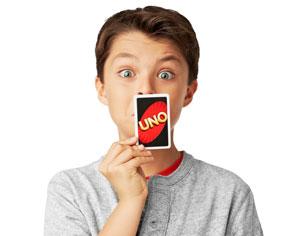 Child playing Uno