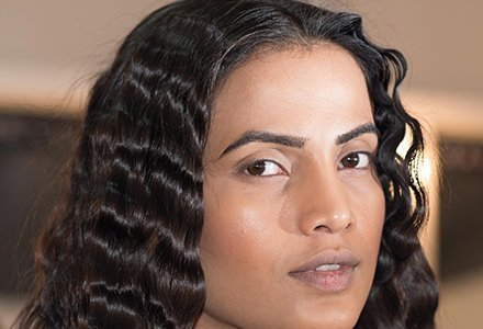 Using a curler start curling in the middle of the hair to protect the ends, tease it with a serum for a stronger hold