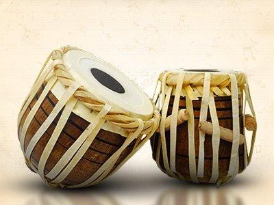 Indian instruments, tablas, harmoniums, sitars, flutes, veena, ghungroo, dholak